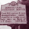 A highway marker noting the first Extension demonstration supervised by a county agent in North Carolina.