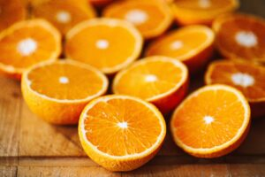 oranges cut into halves on a wooden table